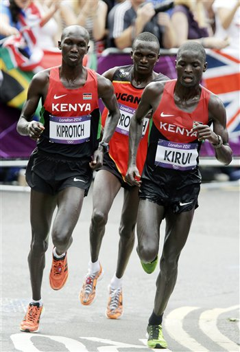 Kenyan marathoners. (Kenyans are endowed with some of the thinnest limbs we've come across.) (From: summergames.ap.org)